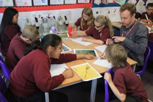 school children using art and poems to explain science