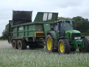 Tractor and trailer at work muck spreading at Morley Farms